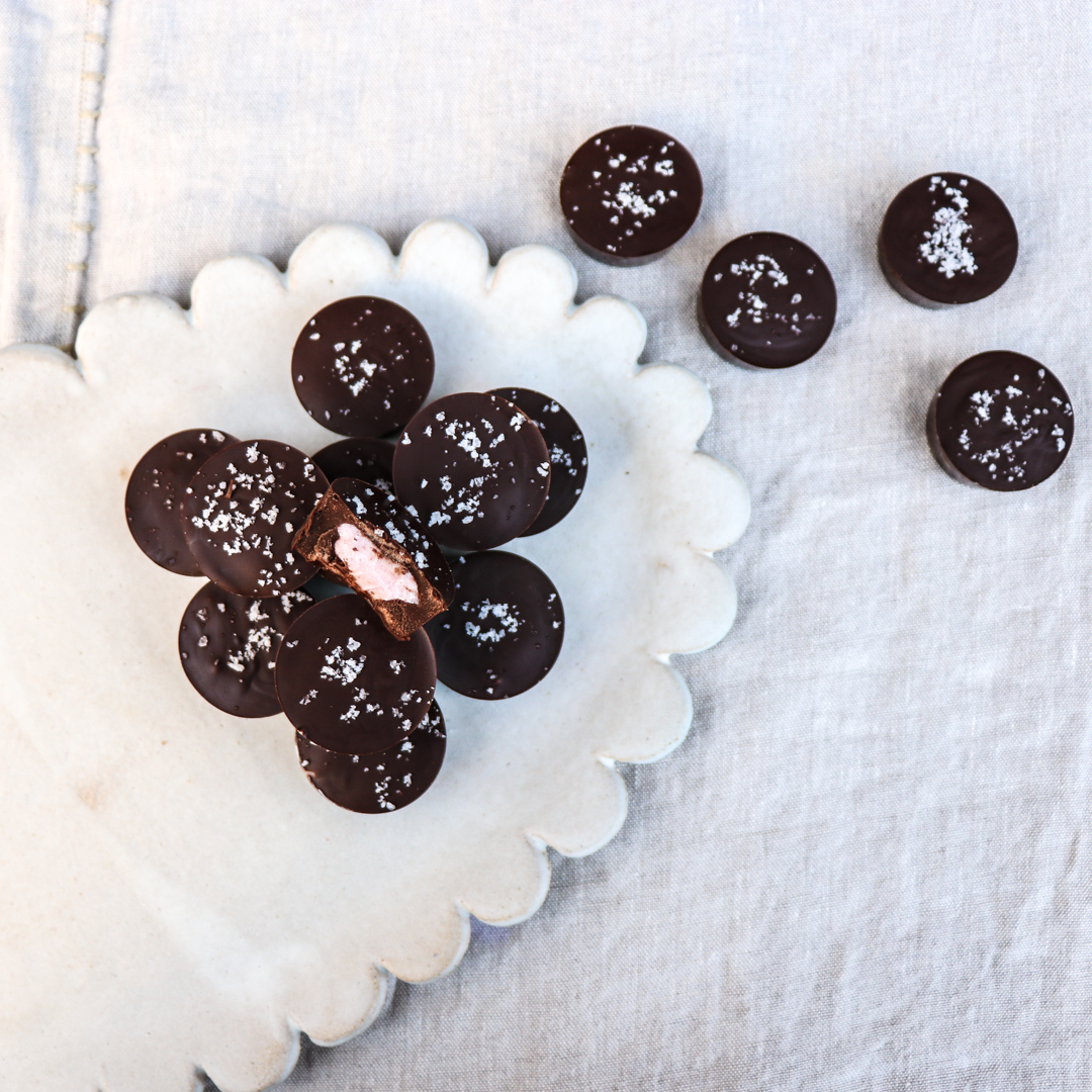 use a touch of natural food coloring in the coconut butter interior of these chocolate candies to reveal the gender of your child to friends and family.